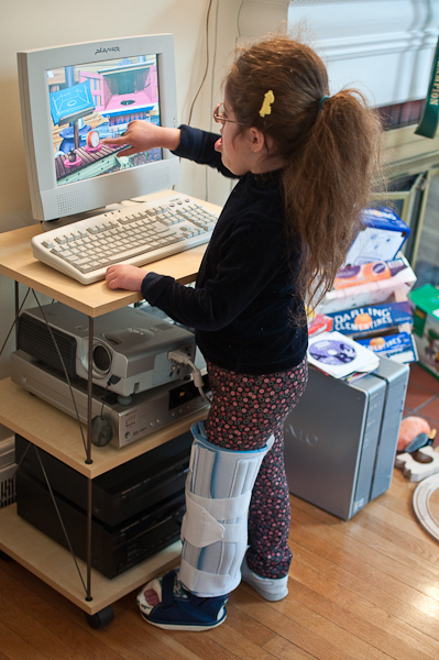 On the computer with the new cast and brace